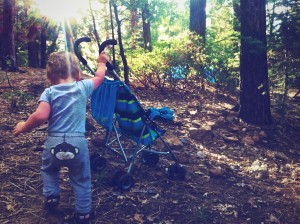 Gabriel pushing the stroller in the forest